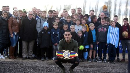 Jordan Gill presents his Commonwealth Featherweight belt at Chatteris Town FC after winning the titl