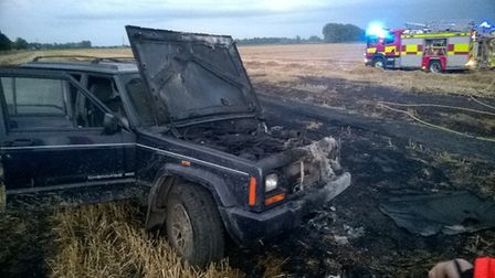 Hare coursers left one of their vehicles after it caught fire when leaving Ely last year. Picture: E