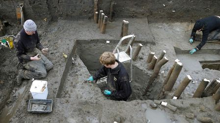 Excavation of the structure's palisade – posts encircling the dwelling site – during the explo