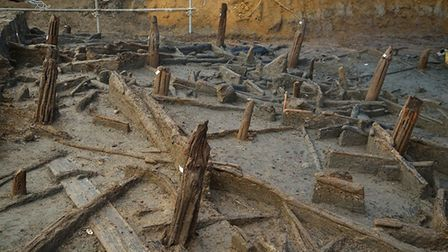 Bronze Age piles preserved within the river silts and collapsed structural timbers. Copyright Cambri