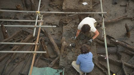 Excavating the site. Removal of river silts to expose the wood. Copyright Cambridge Archaeology Unit