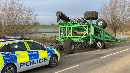 Overturned farm machine closes B1040 in Whittlesey. Picture: @FENCOPS