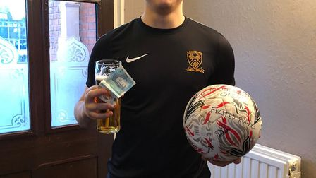 Dom King celebrates after netting a hat-trick for Felsted Rovers