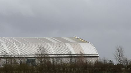 Part of a hangar roof at Duxford war museum that has broken away during Storm Ciara. Picture; Myles