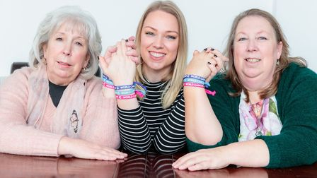 Cambridgeshire family carrying a faulty gene that increases the risk of breast cancer stand united s