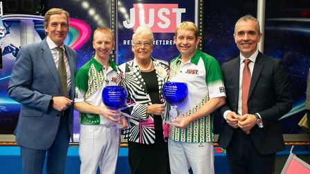 Greg Harlow (second right) and partner Nick Brett (second left) with their Open Pairs trophies at th