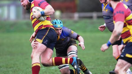 Ely''s Tom Holloway goes in for a tackle. Picture: Steve Wells
