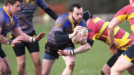 Matty Balmer of Ely Tigers looks for space. Picture: Steve Wells