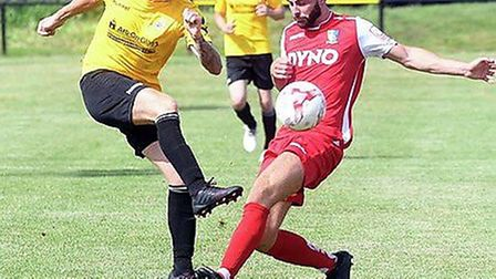 Craig Gillies (left) went off injured during March Town's defeat at Ipswich Wanderers. Picture: IAN
