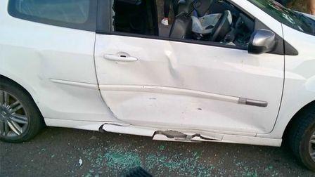 A dangerous driver who rammed a woman's car at least four times with her children in the vehicle has
