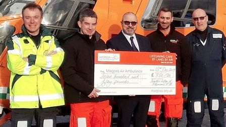 Cambridgeshire Freemasons presented a cheque of £750 to Magpas at RAF Wyton. Picture: CAMBRIDGESHIRE