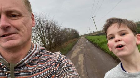 Fenland man Ed Beswick (left) has counted 45 potholes along Stocking Drove in Chatteris. Picture: Fa