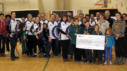 Ely Archers raffle raises £200 for Sutton Scout Group. Pictured is the presentation of the cheque by