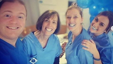Gemma Sessions with work colleagues at So Dental in Chatteris. Picture: SUBMITTED