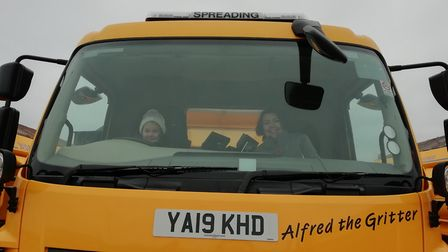 Thea loving sitting on her gritter Alfred the Gritter with her mum. Picture: Supplied/CCC