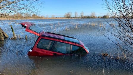 Two hare coursing vehicles are amongst those stuck in the Welney Wash flooding, Fen Cops have reveal