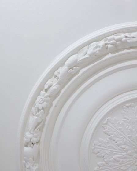 Original ceiling roses have been retained. Picture: Fairview New Homes