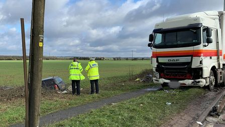 Firefighters and the air ambulance on scene at the crash on the A142 Witcham Toll. Picture: CambsFRS