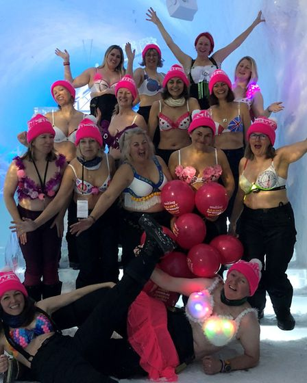 Ginette Heard (first row middle standing) took on the arctic challenge in Sweden with teammates for