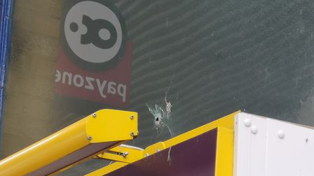 Another gunshot hole at March Service Station and Convenience Store. Picture: Harry Rutter