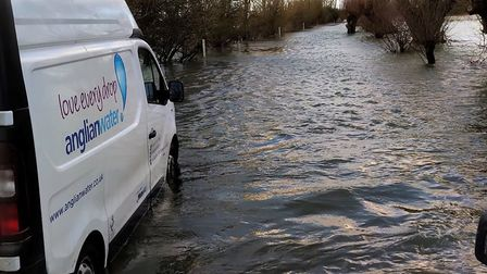 The Anglian Water van with Love Every Drop on the side stuck in Welney Wash. Picture: Facebook/Welne