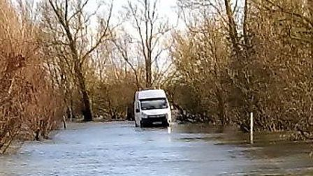 An Anglian Water spokesman has made a statement after a company van driver got stuck in flooded Weln