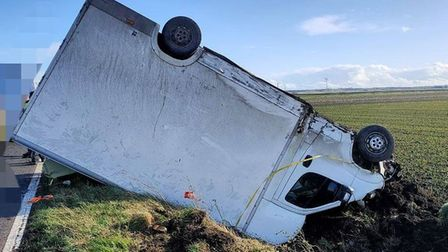 Lucky escape for van driver after he leaves the road and overturns in high winds near Ramsey. Pictur