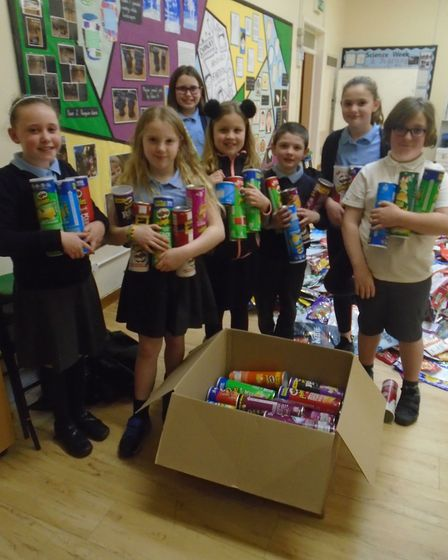 Children from Cavalry Primary School Eco Council are collecting crisp packets and sweet wrappers to