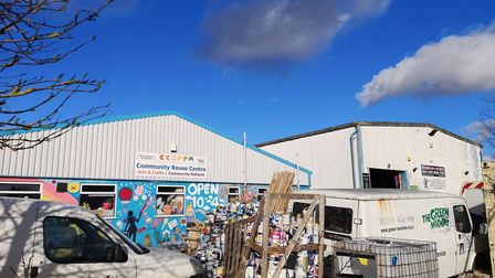 Stacks of paint outside Cambridgeshire Community Reuse & Recycling Network – CCORRN in March have be
