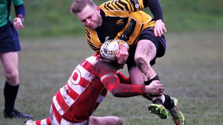 Ely Tigers ace Lory Martin is stopped in his tracks by a Thetford tackler. Picture: STEVE WELLS