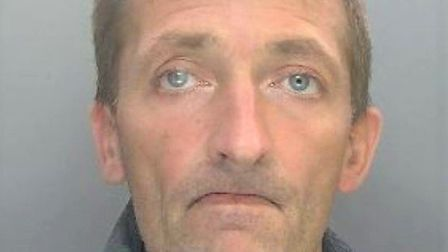 Littleport burglar Adrian Powell, 45, forced his way into a house and beat up a mum of three while h