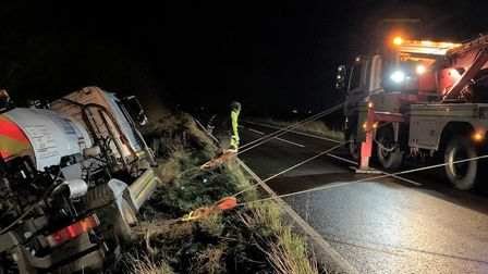 A tanker truck carrying hot liquid came off the road in Whittlesey and ended up on its side in a gra