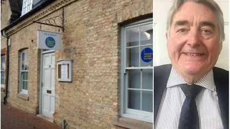 Ely branch of Citizens Advice Rural Cambridgeshire (CARC) is pictured alongside Michael Mealing, cha