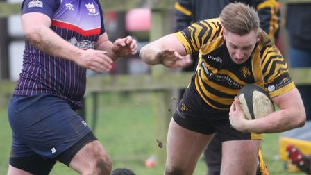 Matt McCarthy gets tackled for Ely Tigers at Thurston. Picture: STEVE WELLS