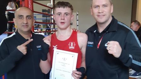 Billy Baxter (centre) with coaches Akif Shirazi (left) and Chris Baker (right) after winning at the