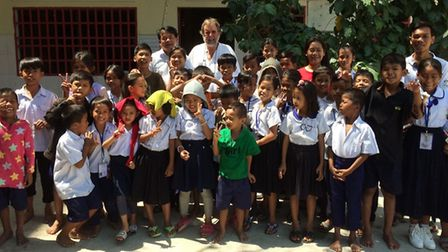 Peter Harris with children from the Centre for Children's Happiness (CCH) in Cambodia. Picture: LIZ