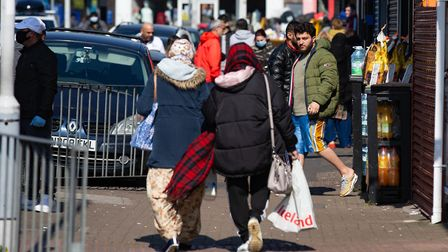 Photographs have emerged of people going about their day on Lincoln Road, Peterborough ignoring the