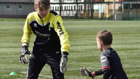 Tom Upshaw (left) from Ely has impressed both on and off the pitch. Picture: FACEBOOK/NORWICH CITY R