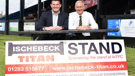 March Town chairman Phil White right with Dan Muzzelwhite, Southern Regional sales manager of Ischeb