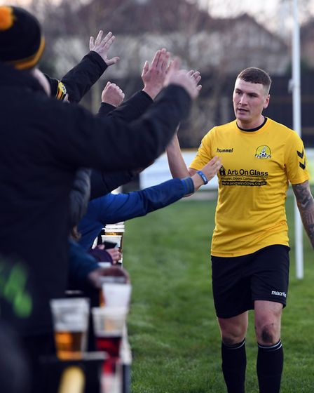 March Town striker Craig Gillies celebrates a goal with supporters during a Thurlow Nunn League Firs