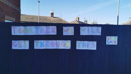 Connor Saunders, 9, posted this poignant message outside his March home,