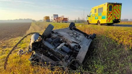 A car ended up upside down in a ditch following a three-vehicle collision on the A141 March by-pass