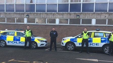 Officers outside March police station with pictures of rainbows attached on their vehicles. Picture: