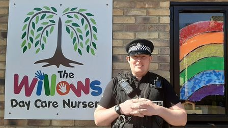 An East Cambridgeshire police officer outside The WIllows Day Care Nursery in Soham. Picture: FACEBO
