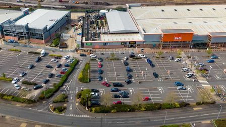 Aerial footage show traffic snaking around car park for B&Q Click and Collect,Maskew Avenue, Peterbo