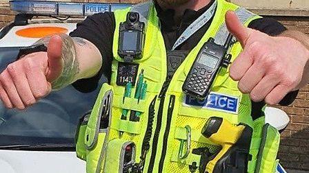 Thumbs up signal by a Cambridgeshire police officer as part of encouragement to stay at home and not