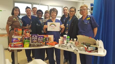 A nurse at St Clare with boxes of fruit for her colleagues