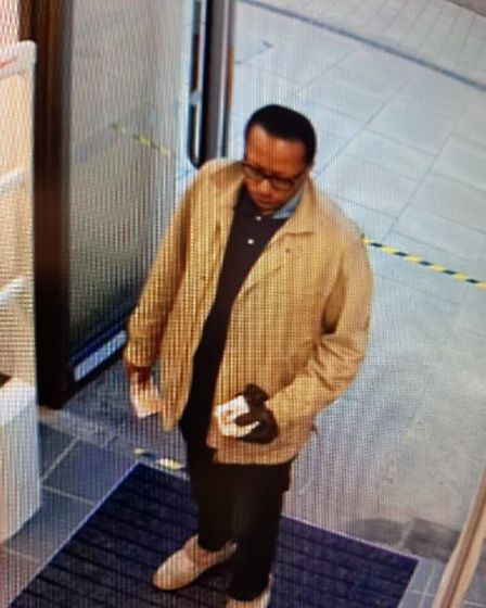 A man police would like to speak with after a Tesco security guard was threatened with a knife when