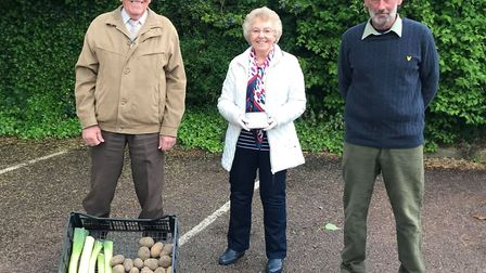 From left: Peter Short, Pauline Short and Tommy Savage with some potatoes and leeks. Picture: SUPPLI