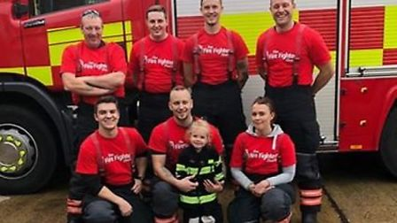 Budding young firefighter Darcey Cook often joins her dad's crew at community events and helps out w